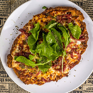 Milanesa mediterránea a la pizza