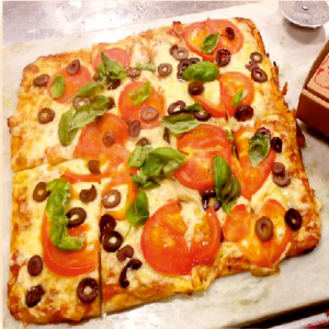 Porcion de pizza capresse