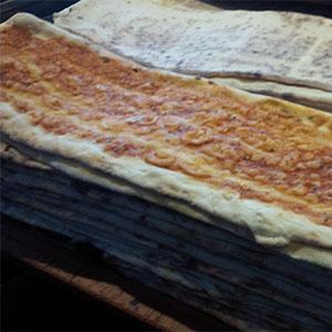Porción pizza común con 2 gustos