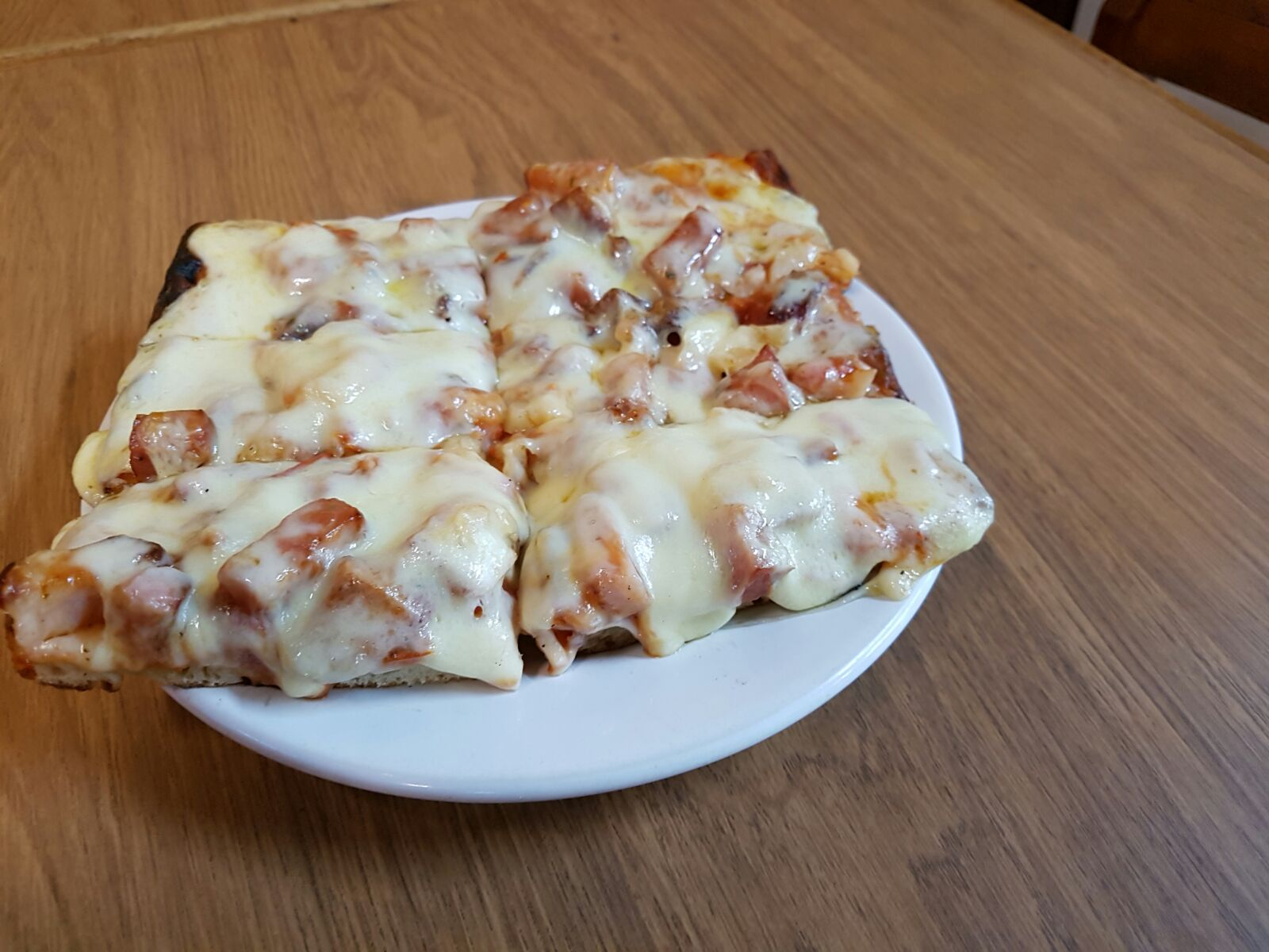 Pizza muzzarella con un gusto (porcion)